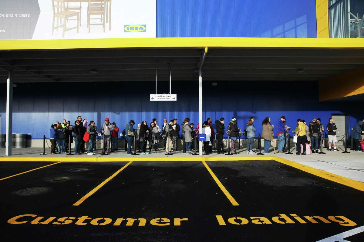 Customers line up to be the first to enter the new Ikea store in Renton.