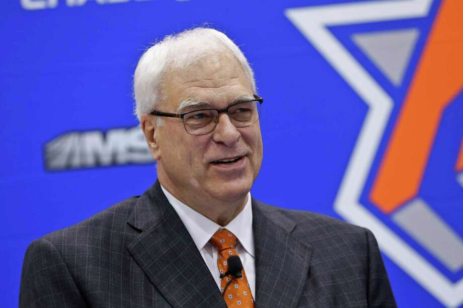 FILE - In this June 3, 2016 file photo, New York Knicks president Phil Jackson, responds to questions during an NBA basketball news conference to announce the hiring of Jeff Hornacek as the head coach in Tarrytown, N.Y.  Jackson has made his relationship with Carmelo Anthony worse and hasn't made the Knicks better. Heading into the trade deadline and nearly three years since he was hired, there are questions if the guy who could do little wrong as a record-setting coach will ever get it right as an executive.(AP Photo/Frank Franklin II, File) ORG XMIT: NYDK250 Photo: Frank Franklin II / Copyright 2016 The Associated Press. All rights reserved. This m