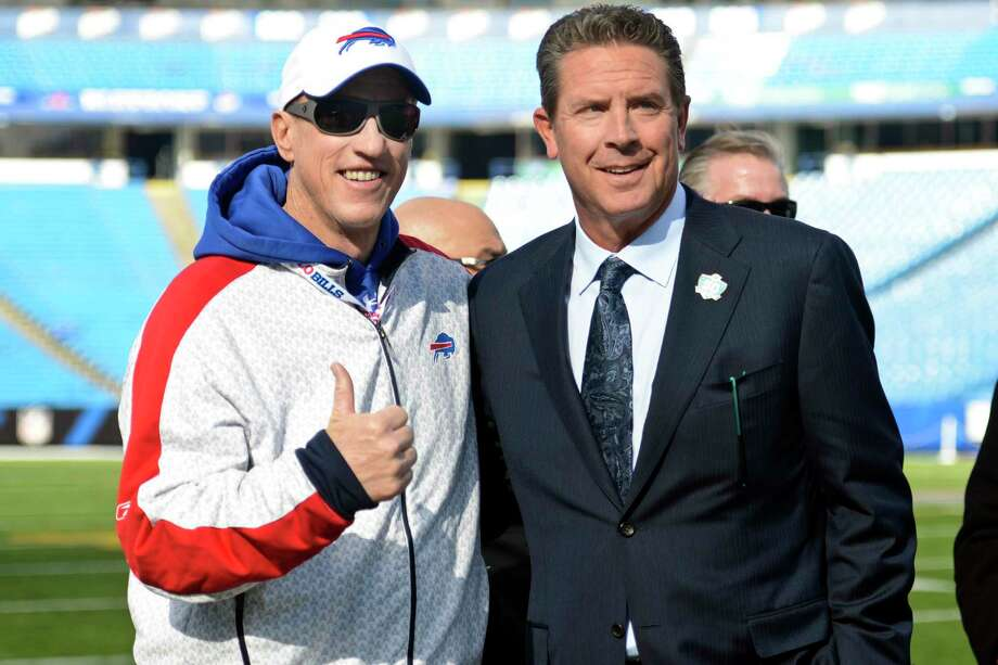 Former quarterbacks Jim Kelly, left, and Dan Marino pose for photographs before an NFL football game between the Buffalo Bills and the Miami Dolphins, Sunday, Nov. 8, 2015, in Orchard Park, N.Y. (AP Photo/Gary Wiepert) ORG XMIT: NYFF101 Photo: Gary Wiepert / FR170498 AP