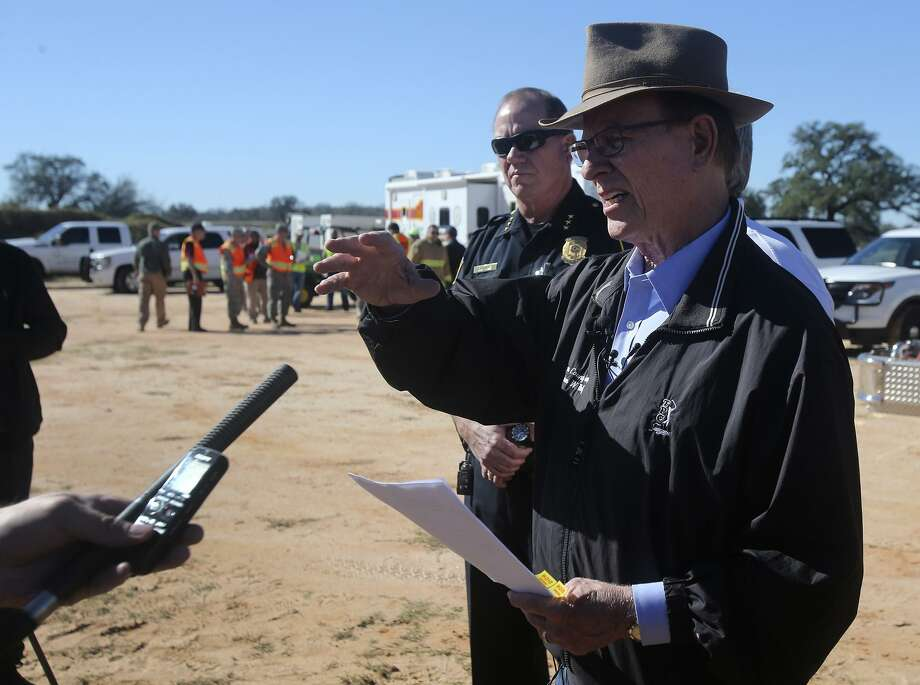 Bexar County Judge Nelson Wolff (right) speaks Wednesday February 22, 2017 to the media about Bexar County's plan to include local suburban cities within the County's Disaster Declaration. The Bexar County Office of Emergency Magagement, the Atascosa County Office of Emergency Management and Joint Base San Antonio first responders simulated a military aircraft crash requiring multi-jurisdictional coordination. The event took place at the Harris sand pit at 23340 Highway 16 South. Photo: John Davenport, Staff / San Antonio Express-News / ©San Antonio Express-News/John Davenport