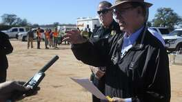 Bexar County Judge Nelson Wolff (right) speaks Wednesday February 22, 2017 to the media about Bexar County's plan to include local suburban cities within the County's Disaster Declaration. The Bexar County Office of Emergency Magagement, the Atascosa County Office of Emergency Management and Joint Base San Antonio first responders simulated a military aircraft crash requiring multi-jurisdictional coordination. The event took place at the Harris sand pit at 23340 Highway 16 South.