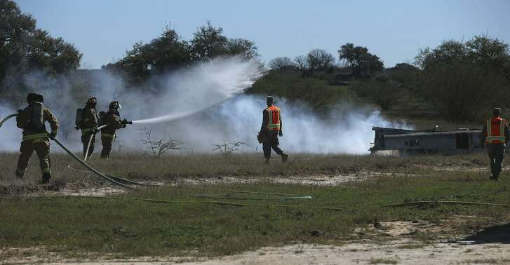 Joint Base San Antonio firefighters take part in a simulated a military aircraft crash. The exercise involved various agencies from Bexar County, Atascosa County and Joint Base San Antonio.