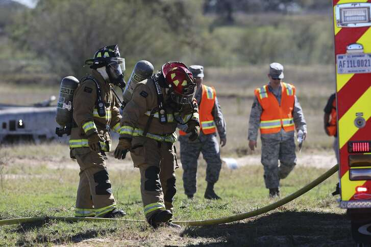 Firefighters from Joint Base San Antonio take part in a simulated a military aircraft crash Wednesday February 22, 2017 requiring multi-jurisdictional coordination. The event was held by the Bexar County Office of Emergency Management, the Atascosa Office of Emergency Management and some local volunteer fire departments. The event took place at the Harris sand pit at 23340 Highway 16 South.