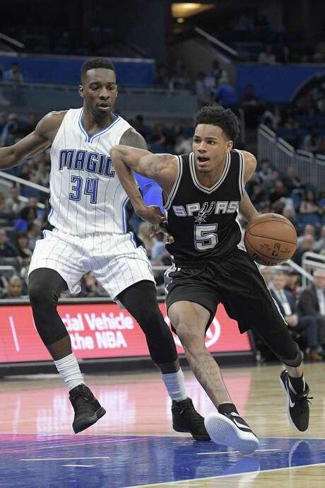 San Antonio Spurs guard Dejounte Murray (5) drives to the basket in front of Orlando Magic forward Jeff Green (34) during the second half of an NBA basketball game in Orlando, Fla., Wednesday, Feb. 15, 2017. The Spurs won 107-79. (AP Photo/Phelan M. Ebenhack) Photo: Phelan M. Ebenhack, FRE / Associated Press / FR121174 AP