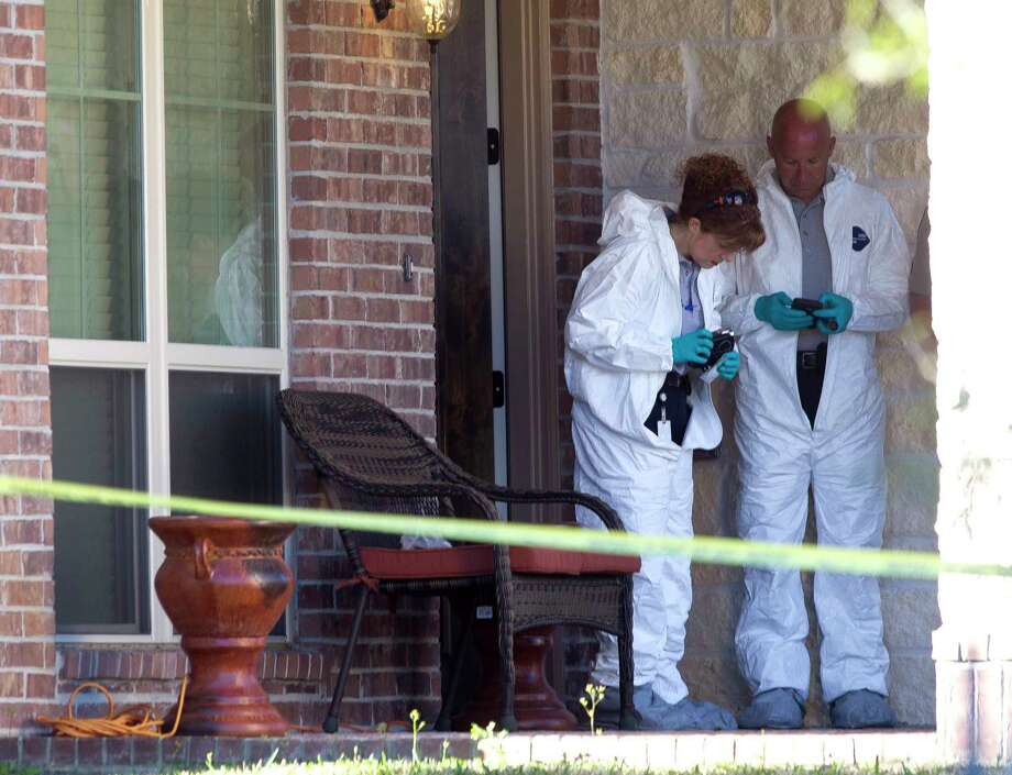 Investigators with the Montgomery County Sheriff's Office work the scene of an officer involved shooting on Chestnut Meadow Court Wednesday in Conroe. An MCSO officer shot and killed a man that stabbed his wife to death. Law enforcement was alerted to the incident after the family's 11-year-old son called 911. Photo: Jason Fochtman, Staff Photographer / © 2017 Houston Chronicle