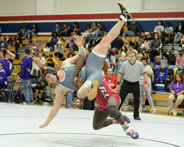 Cameron Barnes of Katy HS takes down Jack Allen of Cinco Ranch on his way to first place in the 220 pound weight class during the boys Region III 6-A UIL Wrestling Championships on Saturday February 18, 2017 at Tompkins HS, Katy, TX.