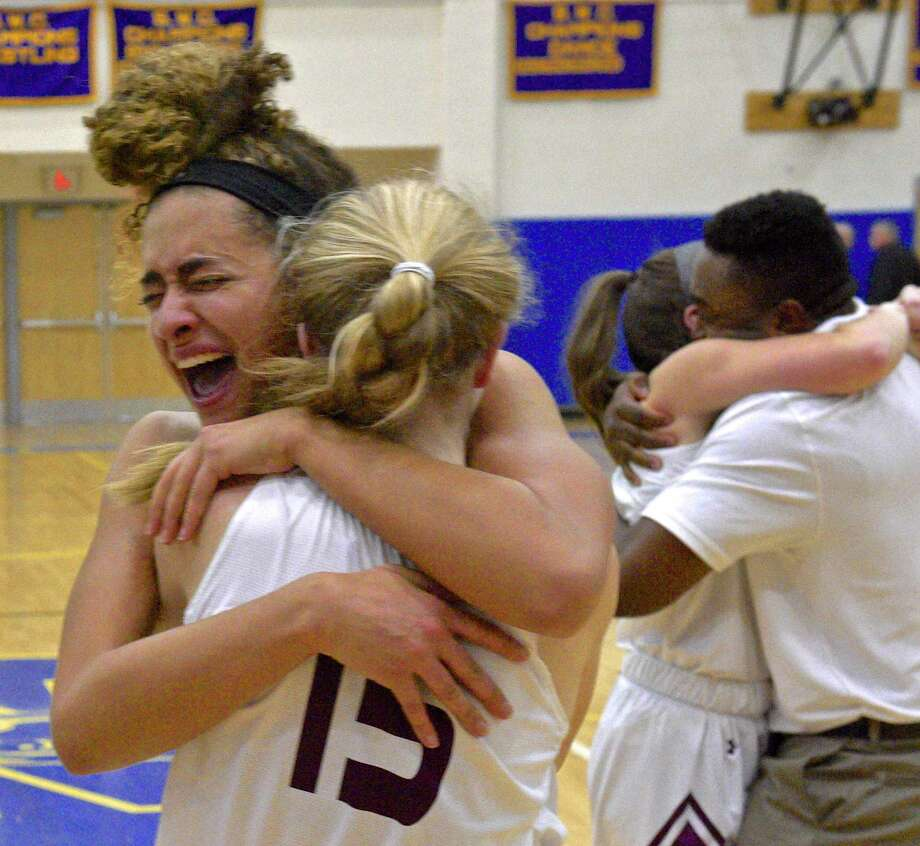 Bethel team captains Amanda Towey (10) and Margaret Dolan (15) hug after Bethel defeated New Fairfield 44 to 37 in the SWC girls basketball championship game between New Fairfield and Bethel high schools. Wednesday February 22, 2017, at Newtown High School, Newtown, Conn. Photo: H John Voorhees III, Hearst Connecticut Media / The News-Times