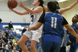 Saratoga's Cathrine Cains drives to the basket during a Class AA girls' basketball game against Albany on Wednesday, Feb. 22, 2017 in Latham, N.Y. (Lori Van Buren / Times Union)
