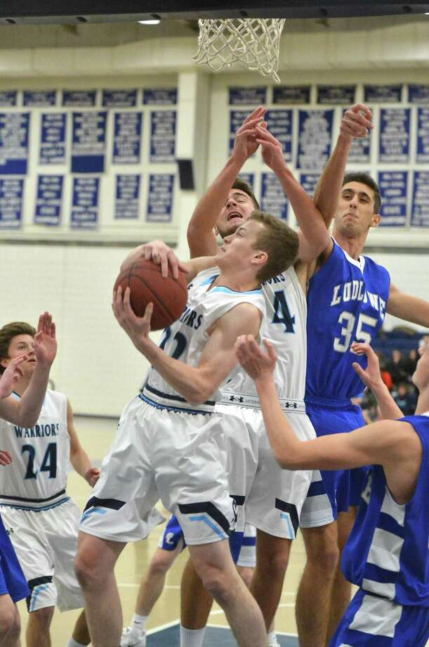 Wilton's #22 Andrew Connolly grabs a rebound vs. Fairfield Ludlowe during boys basketball action at Wilton High School on Wednesday February 22, 2017 in Wilton Conn. Photo: Alex Von Kleydorff / Hearst Connecticut Media / Connecticut Post