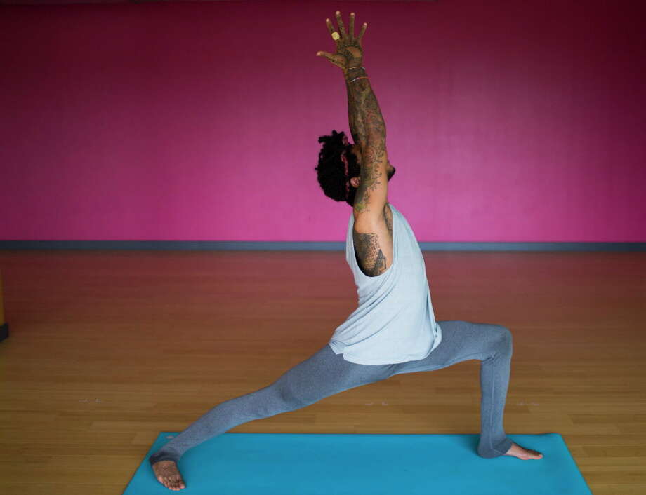 Today's #ChronFit Challenge pose of the day is Warrior 1, demonstrated by Juan Valentine, an instructor at BIG Power Yoga. ( Marie D. De Jesus / Houston Chronicle ) Photo: Marie D. De Jesus, Houston Chronicle / © 2017 Houston Chronicle