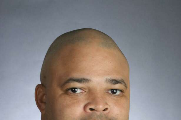 Bo Davis, who will coach the defensive line, was fired at Alabama for alleged recruit ing violations.