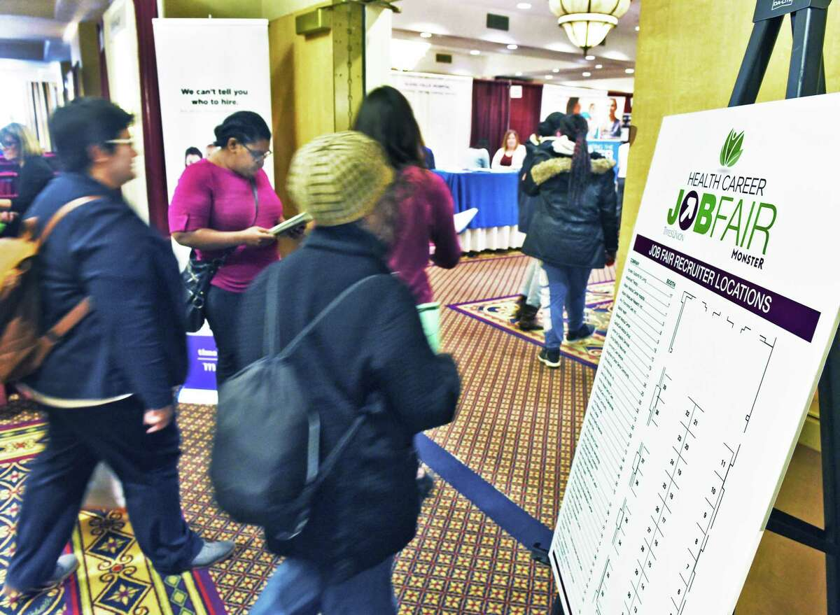 Job seekers file into the annual Times Union health careers job fair Wednesday Feb. 22, 2017, in Colonie, NY. (John Carl D'Annibale / Times Union)