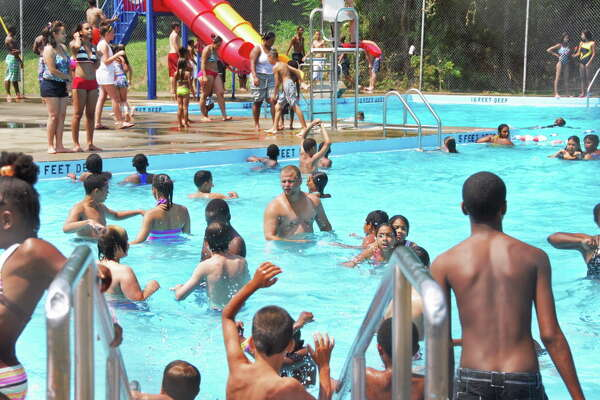 Children having fun and keeping cool at the just opened South Troy Pool Wednesday afternoon July 7, 2010.  (John Carl D'Annibale / Times Union)
