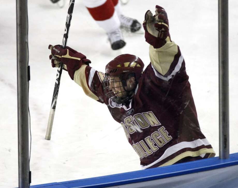 DETROIT - APRIL 10: Cam Atkinson #13 of the Boston College Eagles celebrates a third period goal while playing the Wisconsin Badgers during the championship game of the 2010 NCAA Frozen Four on April 10, 2010 at Ford Field in Detroit, Michigan.  (Photo by Gregory Shamus/Getty Images) *** Local Caption *** Cam Atkinson Photo: Gregory Shamus, Getty Images / 2010 Getty Images