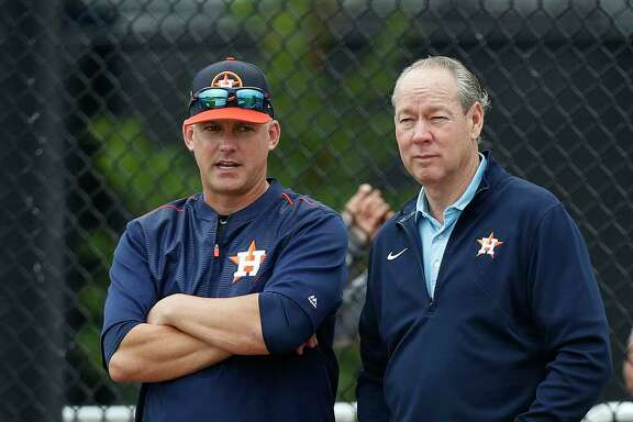 Owner Jim Crane, right, takes in an Astros workout for the first time this spring with skipper A.J. Hinch.