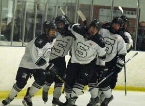 Staples' Evan Mancini, left, celebrates after scoring an early goal in a game against Norwalk-McMahon Wednesday.