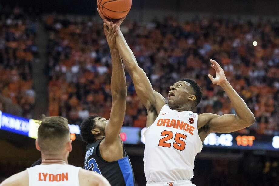 SYRACUSE, NY - FEBRUARY 22:  Tyus Battle #25 of the Syracuse Orange reaches for a rebound during the first half against the Duke Blue Devils on February 22, 2017 at The Carrier Dome in Syracuse, New York.  (Photo by Brett Carlsen/Getty Images) ORG XMIT: 673170621 Photo: Brett Carlsen / 2017 Getty Images