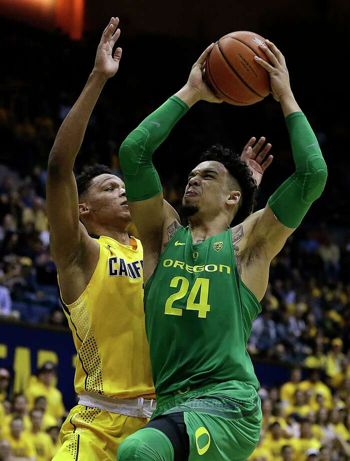 Oregon's Dillon Brooks (24) shoots against California's Ivan Rabb, left, in the first half of an NCAA college basketball game Wednesday, Feb. 22, 2017, in Berkeley, Calif. Photo: Ben Margot, AP / Copyright 2017 The Associated Press. All rights reserved.