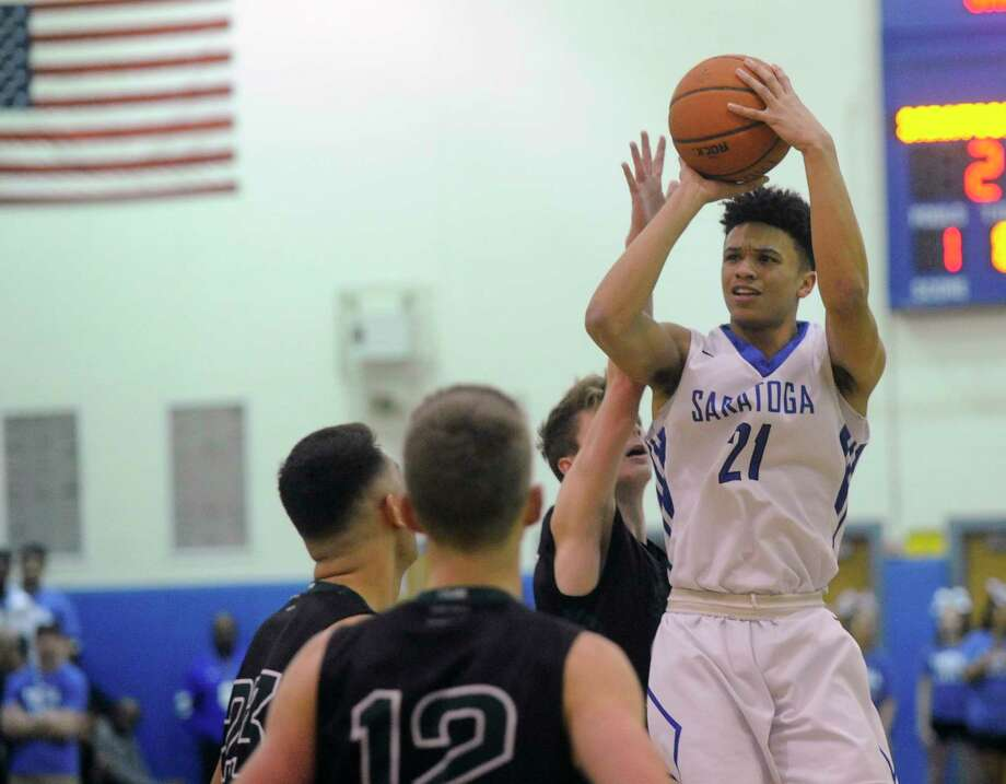 Saratoga's Adam Anderson (21) puts up a shot against Shenendehowa  during the first half of a boys' Section II Class AA high school basketball game on Tuesday, Feb. 214, 2017, in Saratoga Springs, N.Y. (Hans Pennink / Special to the Times Union) ORG XMIT: HP115 Photo: Hans Pennink / Hans Pennink