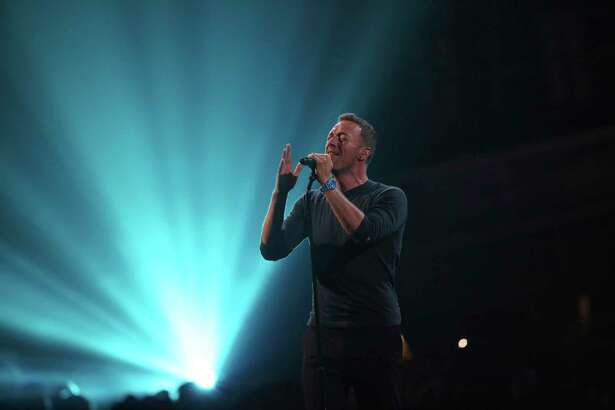 Singer Chris Martin performs a George Michael song on stage at the Brit Awards 2017 in London, Wednesday, Feb. 22, 2017. (Photo by Joel Ryan/Invision/AP) ORG XMIT: LENT177