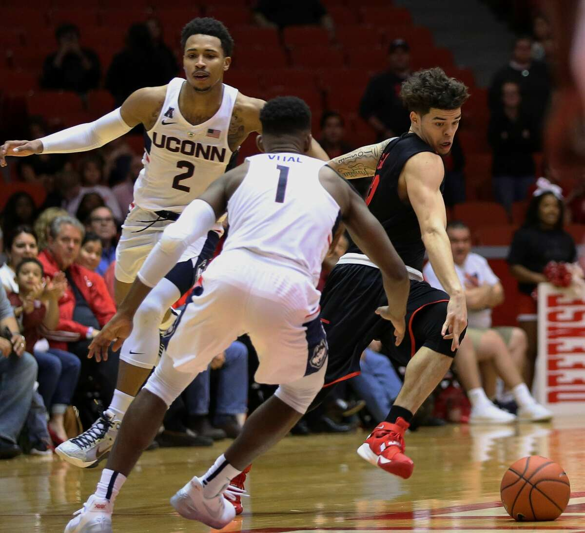 Houston Cougars guard Rob Gray (32) is fouled by Connecticut Huskies guard Christian Vital (1) while dribbling down the court during the second half of the game Wednesday, Feb. 22, 2017, in Houston. ( Yi-Chin Lee / Houston Chronicle )