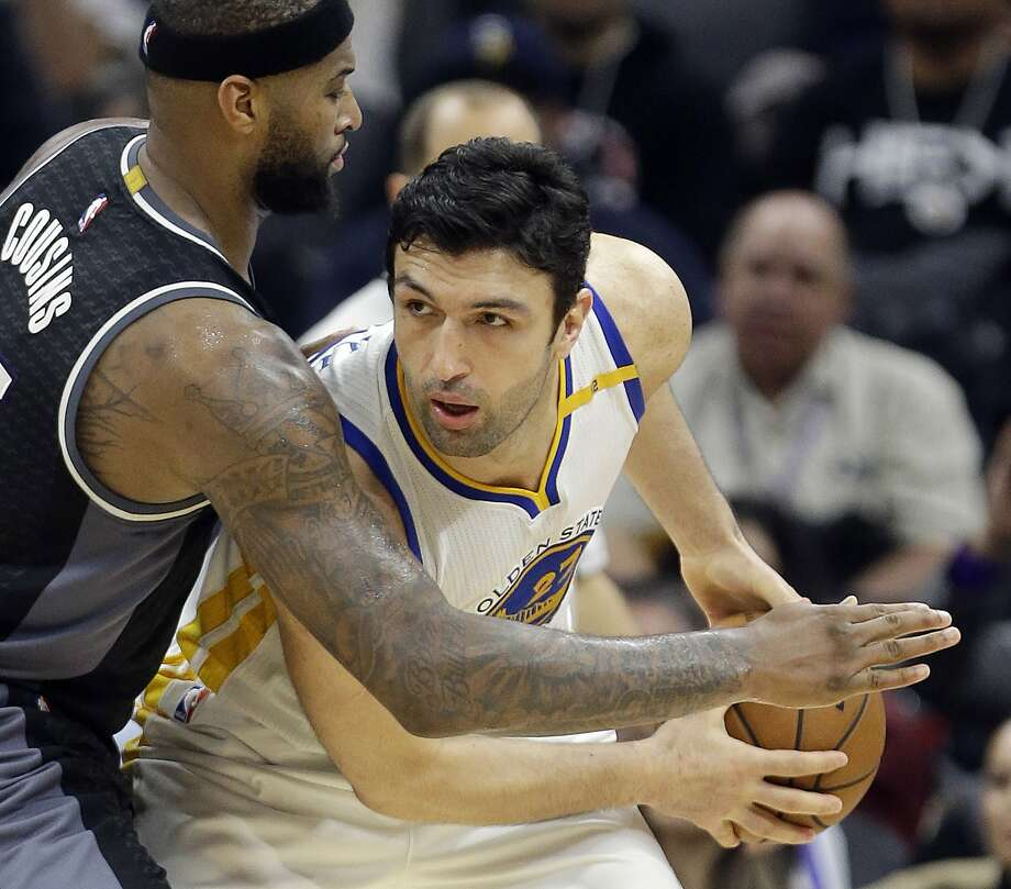 FILE - In this Jan. 8, 2017 file photo, Golden State Warriors center Zaza Pachulia looks past Sacramento Kings forward DeMarcus Cousins during the team's NBA basketball game in Sacramento, Calif. Pachulia is among quite a few Warriors who build team chemistry on flights between games by playing very competitive games of poker. With all that was made before the season about adding Kevin Durant to an already star-studded roster, Golden State's players have jelled just fine. (AP Photo/Rich Pedroncelli, File) Photo: Rich Pedroncelli, Associated Press
