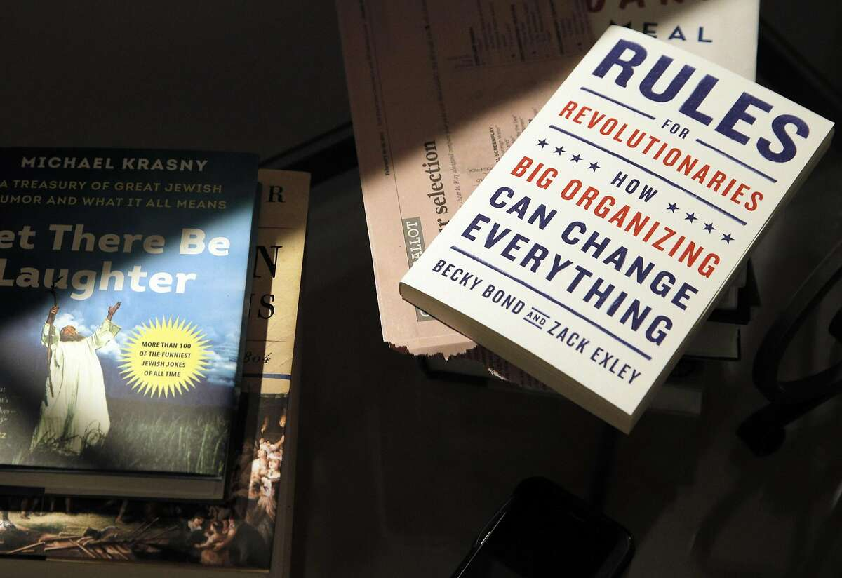 A book about political organizing on the side table during a dinner gathering at the home of Dawn and Doug Bachmann in Martinez, Calif., on Sunday, February 19, 2017. A group of friends have been gathering for 15 years for bi-monthly Sunday dinners, usually for holidays and the Academy Awards. Then the election happened, and now the friends have named themselves the Gourmet Resistance Activist Networking Team. And the dinners will now serve as political grassroots action meetings.