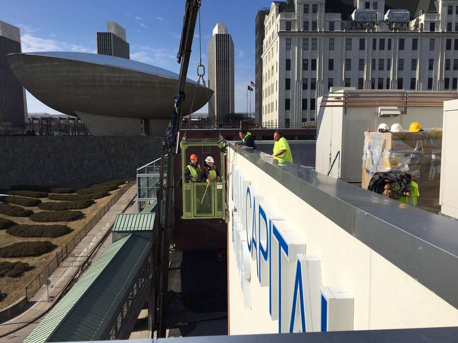 Saxton Sign Corp. finishes installing the Albany Capital Center sign on the south side of the convention center facing Madison Avenue in Albany on Thursday, Feb. 23, 2017. (Photo courtesy of Saxton Sign Corp.)