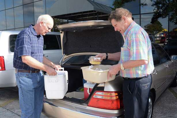 Ray Sidenblad and Bob Jennings double check the meals they will deliver at the Northwest Assistance Ministries, 15555 Kuykendahl Road, Meals on Wheels program.