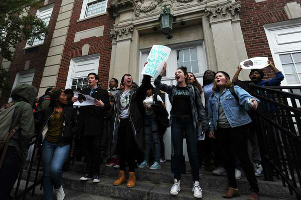 17-year-old Dominika Brice, center left, and Cara Grosso, 16, lead a chant during the Stamford High School walkout to protest the new U.S. Secretary of Education Betsy DeVos in Stamford, Conn. on Thursday, Feb. 23, 2017.