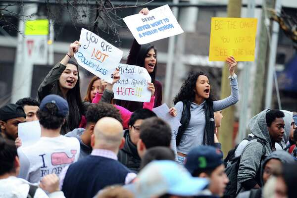 18-year-old Stamford High School student Fanny Cabrera, right, and Jairy Sandoval, 17, chant against new U.S. Secretary of Education Betsy DeVos during a planned walkout in Stamford, Conn. on Thursday, Feb. 23, 2017.