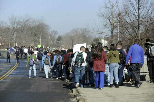 Danbury High School students staged a walkout Thursday morning to protest authorities' decision not to prosecute a man who taunted minority students after school Jan. 20.