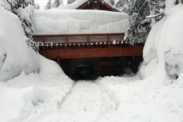 Snow piled up on a cabin in Serene Lakes, Soda Springs, Calif., on Feb. 22, 2017.