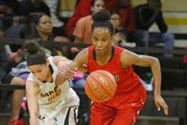 Wagner's Kiana Williams pushes the ball at East Central on Tuesday, December 21, 2016. (staff photo)