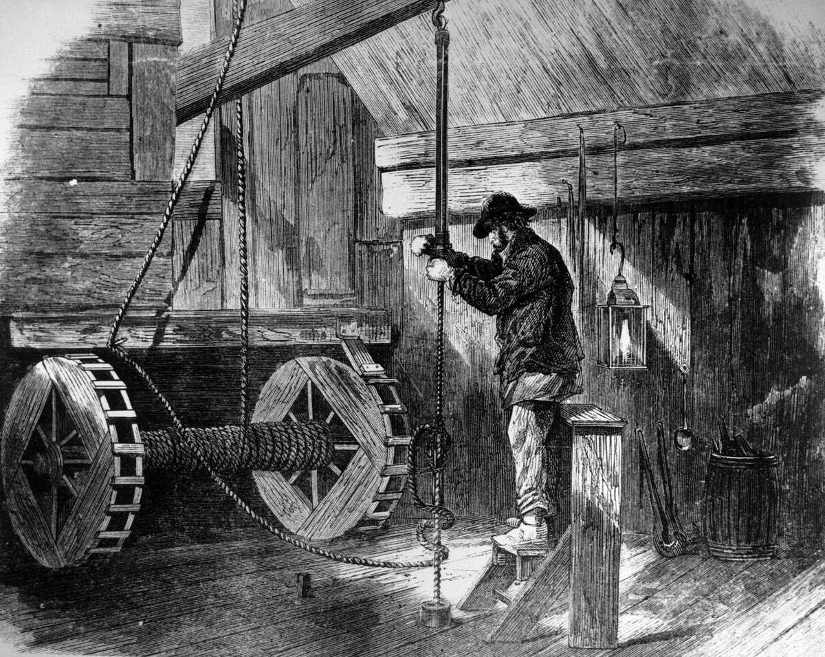 Dec. 31, 1869 : Inside a derrick, drilling for oil.