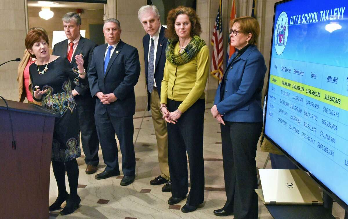 Mayor Kathy Sheehan, left, is joined by state and city officials to outline an advocacy campaign for Capital City Funding during a City Hall news conference Thursday, Feb. 23, 2017 in Albany, NY. (JohnCarl D'Annibale / Times Union)