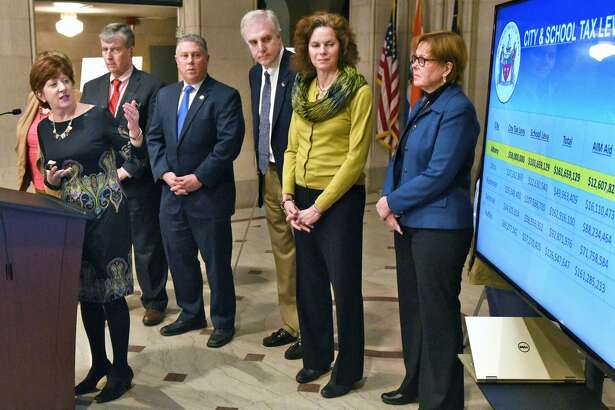 Mayor Kathy Sheehan, left, is joined by state and city officials to outline an advocacy campaign for Capital City Funding during a City Hall news conference Thursday,  Feb  .  23  , 2017 in Albany, NY. (  John  Carl  D'Annibale / Times Union)