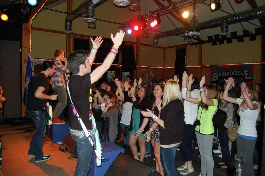 A crowd of Wilton high schoolers crowd around the stage at one of Trackside's concerts. Photo: Contributed Photo