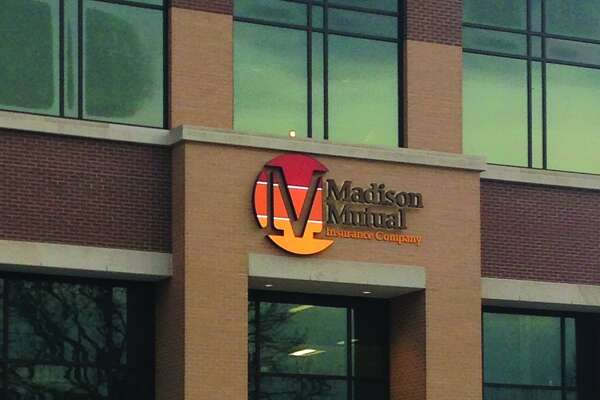 Madison Mutual Insurance Company's signs went up last week on the five-story Park Plaza development in downtown Edwardsville. The skyline-changing structure will also be home to a new restaurant, Crushed Red.