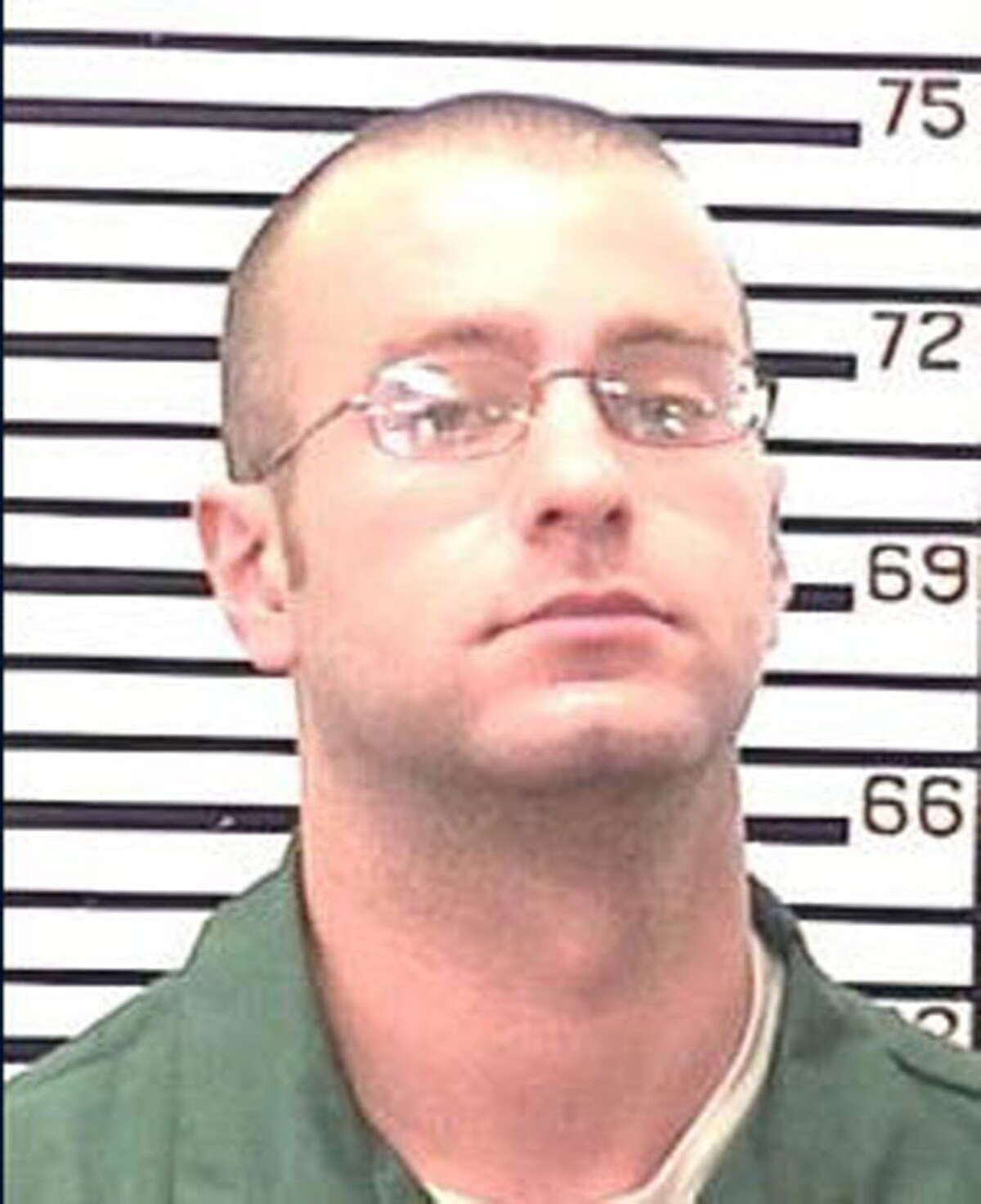Christopher Porco, 28, pictured here in a prison mugshot taken at state prison in November 2009.