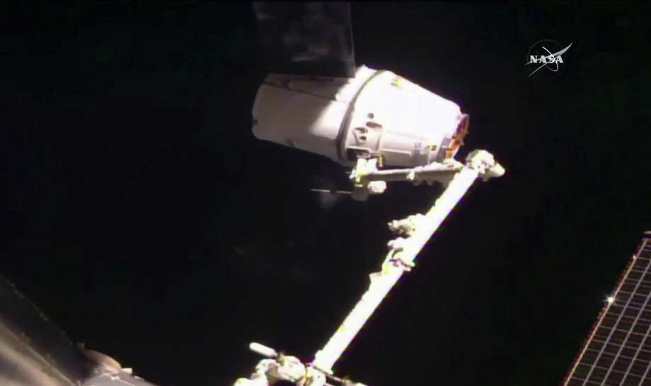 SpaceX's Dragon cargo ship is captured Thursday by astronauts on the International Space Station. Photo: NASA TV / NASA TV