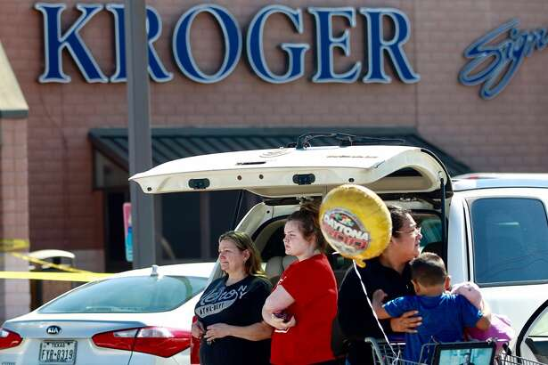 Patricia Jessie, left, waits with her granddaughter, Bryanna, to talk with law enforcement at a Kroger after four men robbed the grocery store at U. S. 59 near FM 1314 around 10:45 a.m. Thursday, Feb 23, 2017, in Porter. Patricia Jessie was waiting to hear from her daughter, Nichole, who worked at the store's courtesy booth at the time of the robbery. The suspects fled the scene and led law enforcement on a high-speed chase. Three men have been detained near Rankin Road and West Hardy with one still on the loose. No injuries were reported.