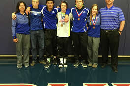 Friendswood wrestlers headed to this weekend's state tournament are (left to right)Kayla Molina,Mitchell Horn (manager),Manny Elizondo,Baily West,Brodey Beckman,Amber Prichard and coach Michael Lowe.