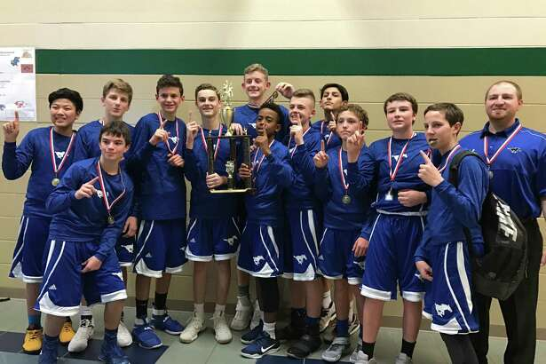 The Friendswood eighth grade boys' basketball team recently won the district championship at Bayside Intermediate. The Mustangs beat Seabrook and Creekside in the first and second rounds of the tournament before topping Victory Lakes in the final. Team members areNick Alfonso, Caden Cannon, Jack Ehrman, Travis Gibbons, Matthew Kovacevich, Blake Lewis, Luke Lawyer, Eric Li, Connor Rickards, Nick Spencer, Bryant Wade, Wade Winters. The team is coached byMatt Veariel.