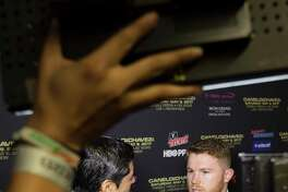 Canelo Alvarez is interviewed during a press tour event promoting the fight between Avlarez and Julio Cesar Chavez at Minute Maid Park on Thursday, Feb. 23, 2017, in Houston.