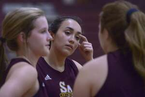 Sarah Gwin, middle, speaks with teammates during San Antonio Christian practice on Wednesday, Feb. 22, 2017. They will be going to the TAPPS tournament in Abilene.