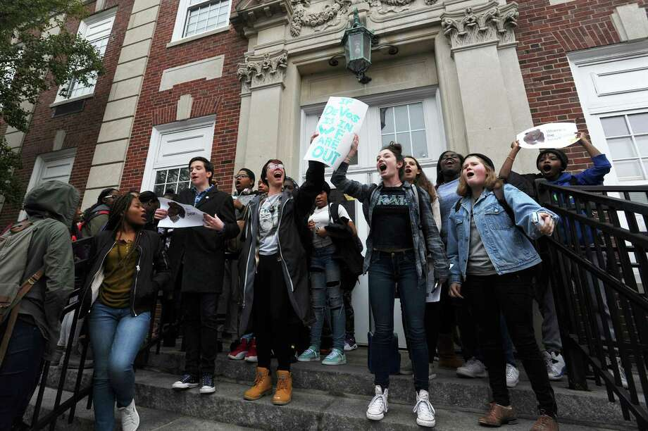 Dominika Brice, 17, center left, and Cara Grosso, 16, lead a chant during the Stamford High School walkout to protest the new U.S. Secretary of Education Betsy DeVos in Stamford on Thursday. Photo: Michael Cummo / Hearst Connecticut Media / Stamford Advocate