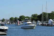 A boater navigates their boat into Stamford Harbor in Stamford on Friday, June 10, 2016.