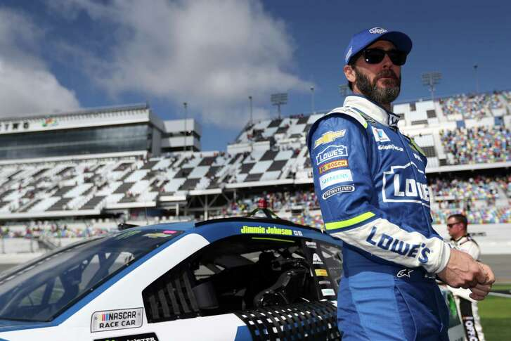 DAYTONA BEACH, FL - FEBRUARY 19:  Jimmie Johnson, driver of the #48 Lowe's Chevrolet, stands on the grid during pre-race ceremonies for the weather delayed Monster Energy NASCAR Cup Series Advance Auto Parts Clash at Daytona International Speedway on February 19, 2017 in Daytona Beach, Florida.  (Photo by Chris Graythen/Getty Images)
