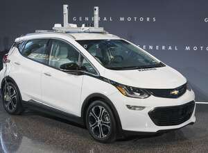 In this photo provided by General Motors a self-driving car is seen in Detroit. General Motors is trying to persuade state lawmakers across the country to pass legislation that would clear the way for the automaker to make self-driving cars publicly available while potentially barring GM�s competitors from putting their own vehicles on the road.  (Photo by Steve Fecht for General Motors)